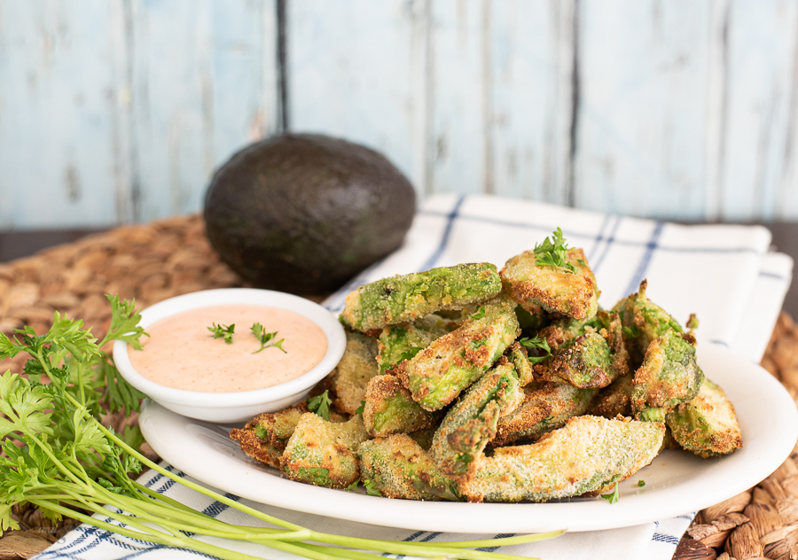 Air Fried Avocado Fries with sriracha ranch dipping sauce served on a platter.