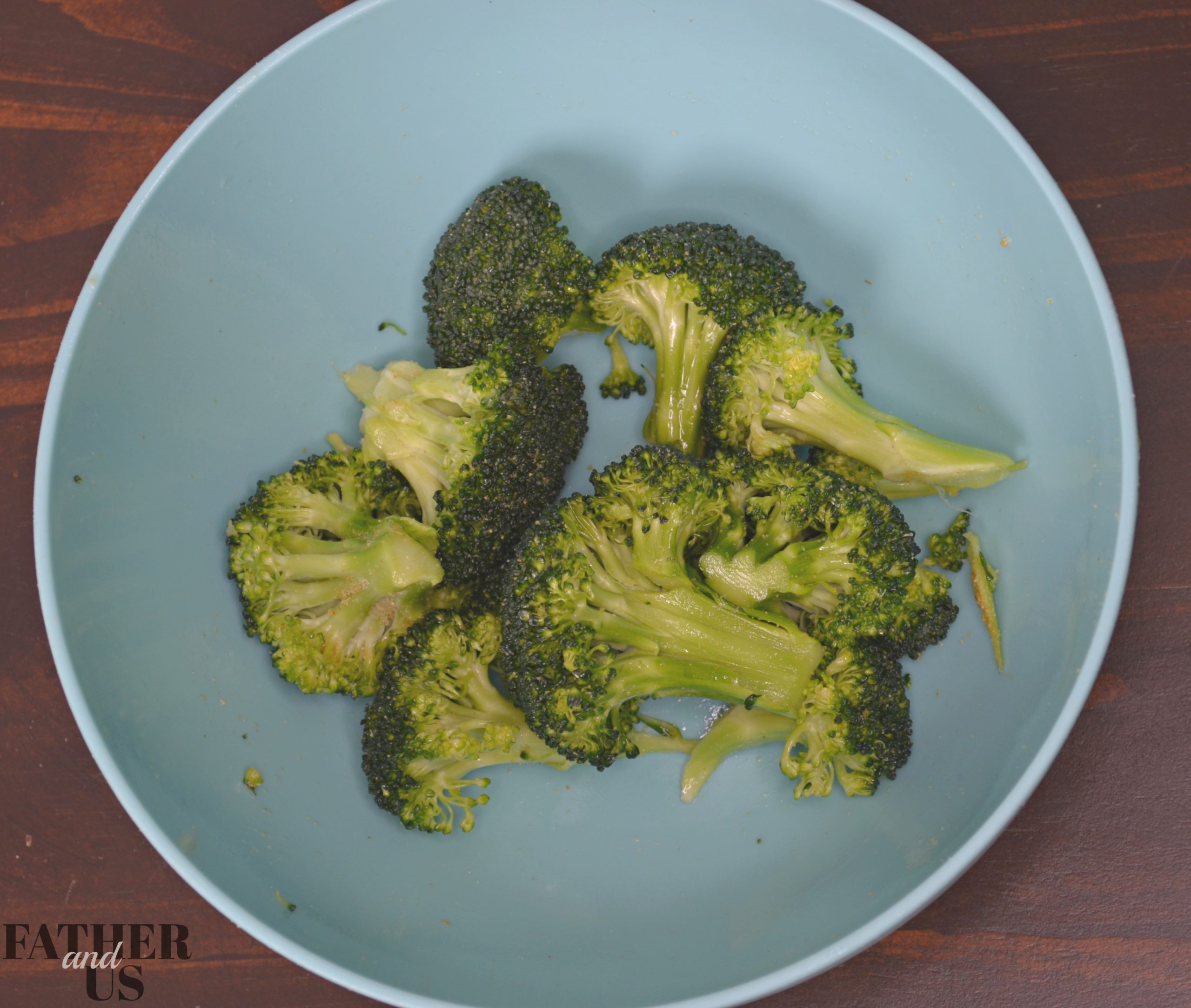 making Air Fryer Broccoli involves mixing the vegetables, oil and seasonings together before cookinig