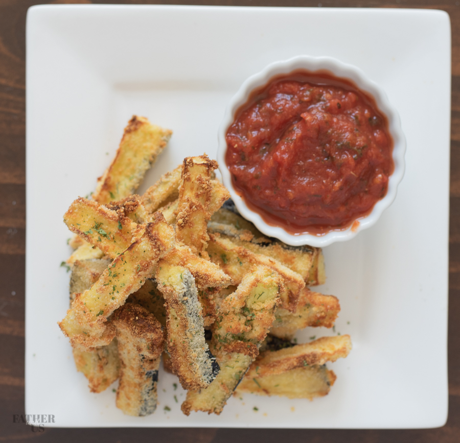 Air Fryer Eggplant Fries served with a side of marinara sauce.